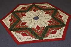 pattern is Eleanor Burns Diamond Log Cabin Tree Skirt, the fabric is Moda's Nature's Gift with warm and natural batting.