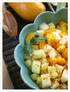Mango, Jicama, and Cucumber Salad - Muy Bueno Cookbook  The warm weather is approaching and there is nothing I enjoy more than frolicking in the sun and less time in the kitchen, at the hot stove or oven.   This salad is a nice change from the standard green salad. It's perfect for a picnic, potluck, or on the buffet table at your next fiesta. This salad has a fresh crunch and spicy kick. This refreshing side dish incorporates chopped mango, jicama, cucumber, and freshly squeezed lime juice.