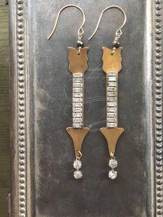 A personal favorite from my Etsy shop https://www.etsy.com/listing/598804201/art-deco-rhinestone-arrow-earrings