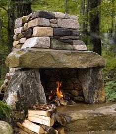 Rustic Outdoor Fireplace - Adventure Time This on a piece of property with eye hooks to attach tarps to create an awesome tent camping experience.