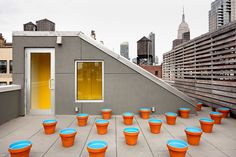 A garden of empty flowerpots was designed by the landscape architect Martha Schwartz for the Littmans' son's wedding at their beachhouse and transplanted to the roof here.        Recommend      Twitter      Linkedin      E-Mail      Share    Related        Article: Escaping to the City's Bustle