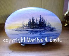 A little lake scene on a rock washed smooth by the waves of Lake Superior.  SOLD