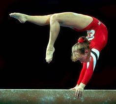 American gymnast Kim Zmeskal performing handstand on balance beam.
