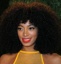 Afro + bright red matte lips + gold shadow (Solange Knowles)