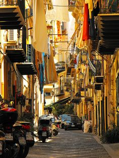 Cozy atmosphere in a typical street of the old town of Cefalù, Sicily, Italy (by Miguel Virkkunen Carvalho).