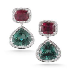 7.06 carats of rubellite anchored by 20.49 carats of faceted teardrop green tourmaline set in 14K white gold.