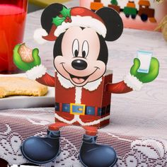 Santa Mickey will light up any room this Christmas. And as if he wasn't already full of holiday cheer -- he holds candy!