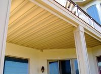 This product is called an underdeck ceiling and it's a great addition to a second story deck.  It keeps rain water from dripping through the cracks and creates a lower level storage area. Here's how much it costs.