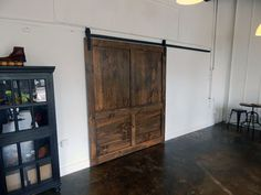 ****PLEASE READ THIS AD IN ITS ENTIRETY BEFORE CONTACTING US OR ORDERING**** CURRENT LEAD TIME: 12 WEEKS. Lead time DOES NOT include shipping time which may be additional. Large Barn Doors, custom made to order and handcrafted in Atlanta, Georgia. This barn door was made for Cobbler Union in Inman Park, Atlanta. These doors are great for commerical spaces and can cover large openings. Our classic framed doors feature a typical stile and rail construction much like a regular interior door…