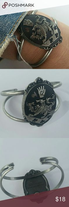 LION CUFF Lion crest antique silver metal cuff.  Tiny chip of black paint missing by hand on imprint.  Not noticeable,  very chic peice. boutique  Jewelry Bracelets