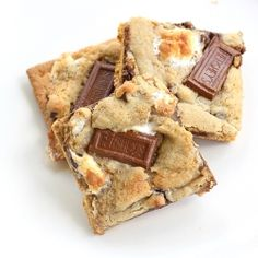 S'mores Cookies - gooey chocolate chip and marshmalllow cookies on top of a graham cracker.