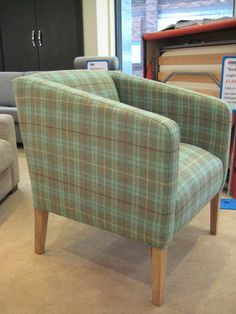 This modern tub chair has a 50 cm seat with a higher back for the wheel-chair using owner to sit more comfortably.  It is covered in Linwood Roxburgh Shetland wool (LF927FR) 6 lochwood.