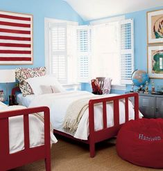 Sports trophies are displayed on locker-style furniture in this 10-year-old boy's room. The twin beds once belonged to his                             grandmother and are updated with fire engine red lacquer