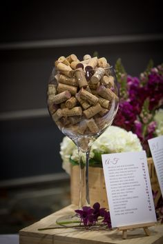 Winery wedding ... Large wine glass decor filled with used wine corks ... Perfect accents on guest book table and cake table