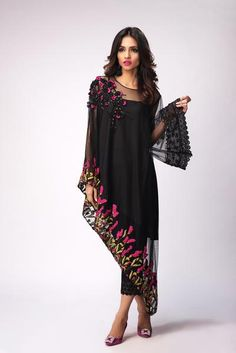 Choose this flattering net cape as your partner in crime for the evening. The stunning embroidery and sequin detailing make this the perfect outfit for a bold and daring fashionista. Can be made with sleeves on the slip. Stylish Dresses For Girls, Stylish Dress Designs, Unique Dresses, Elegant Dresses, Casual Dresses, Elegant Clothing, Pakistani Fashion Casual, Pakistani Dress Design, Pakistani Outfits