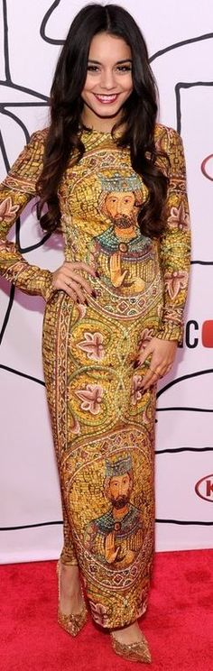 Who made Vanessa Hudgens' yellow long sleeve print gown? Dress – Dolce & Gabbana