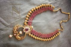 Ruby necklace with a touch of traditional design from Nikitha Linga in Hyderabad attached to a chand bali shaped nakshi work pendant in twin peacock design India Jewelry, Temple Jewellery, Jewellery Shops, Antique Necklace, Antique Jewelry, Antique Gold, Ruby Necklace Designs, Jewelery, Jewelry Necklaces