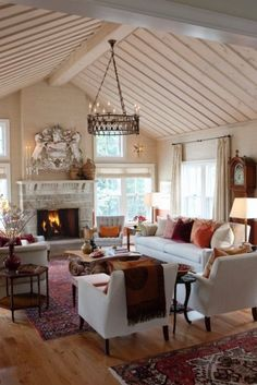 I recognize this as Sarah Richardon's work. Love the arch. salvage piece over the fireplace.