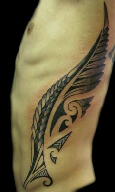 Tattoos - Blackwork tattoos - Maori tribal wing or fern rib tattoo