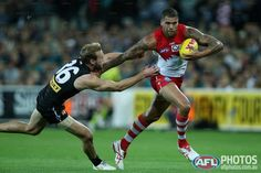 AFL Round two - Buddy Franklin breaks the tackle Melbourne, Sydney, Australian Football League, Round Two, Swans, In This Moment, Club, Running, Sports
