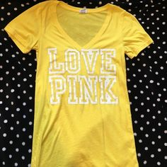 Victoria's Secret pink yellow Vneck This shirt has been lovingly worn but still has a lot of wear left to it. PINK Victoria's Secret Tops Tees - Short Sleeve