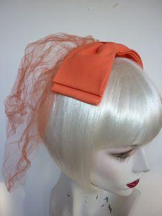 1960s MOD Bridesmaid Headpiece / Bow / Veil / Fascinator in ORANGE. $34.00, via Etsy.