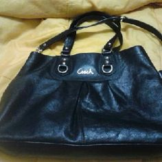 "Coach Ashley Leather Carryall F15513 A beautiful black leather coach bag with purple lining. In excellent condition. It does not have a hang tag unfortunately. Only used once on a business trip.    Features: Inside zip and multifunction pockets Double snap closure Approx 15"" L x 10.5 H x 3.5 W Retail was $398   Reasonable offers accepted:) Coach Bags Satchels"