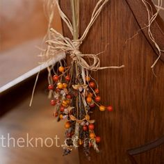 Dried grass, wheat, and fall-colored berries were tied with natural colored raffia and twine and hung from the end of each pew. - Wedding Day Pins : You're Source for Wedding Pins! Wedding Pew Decorations, Wedding Pews, Flower Decorations, Fall Wedding, Rustic Wedding, Our Wedding, Wedding Flowers, Wedding Stuff, Fall Decorations