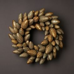 Pine cone wreath  Looks as though they used plastic ones on this wreath. I'm going to spray paint some real ones in silver and gold and use those instead!