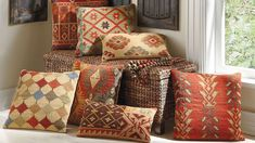 Hello pillows.  I need each one!    Crafted on traditional kilim looms, the exciting patterns and rich colors make these Kilim Throw Pillows timeless favorites to spice up any seat in the house.   Grandin Road Color Crush on Burnt Orange