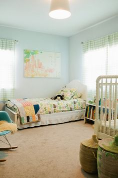 """Sneak Peek: Raya Carlisle """"Our house is a two bedroom, so the kids share. I did most of the decorating when Baker was small but tried to make it neutral enough to last. The paint is Sherwin Williams """"Nurture."""" The bedding is Dwell Studio for Target, the curtains are Land of Nod and the big art piece is from Ikea."""" #sneakpeek"""