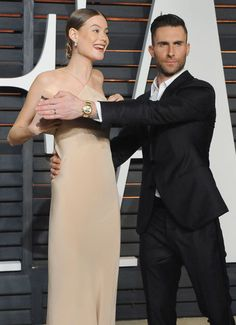 Behati Prinsloo and Adam Levine. See the 40 other cutest celebrity couple PDA moments.