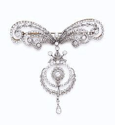 A DELICATE BELLE EPOQUE PEARL AND DIAMOND BOW BROOCH, BY CARTIER