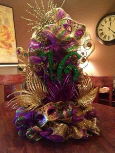 Celebrate Fat Tuesday with stunning Mardi Gras decorations. Check out Mardi Gras DIY Decorations ideas here. These are easy and best Mardi Gras decor ideas. Mardi Gras Wreath, Mardi Gras Beads, Mardi Gras Party, Mardi Gras Centerpieces, Mardi Gras Decorations, Wedding Centerpieces, Disney Centerpieces, Masquerade Decorations, Birthday Centerpieces