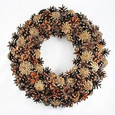 Natural wreath of pine cones. Stylish and beautiful. The base of the everyday wreath is made of straw and wrapped in burlap. The diameter is 40 cm (15.75 inches). Such a wreath can decorate the house all year round, but it is better in winter or autumn. This wreath can be presented