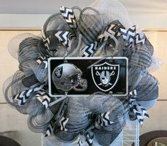Hey, I found this really awesome Etsy listing at http://www.etsy.com/listing/164368345/oakland-raiders-mesh-wreath