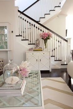 what makes this room crisp is the pop of the dark floor and stair against all the cream. without that contrast it could feel washed out.