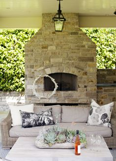 Stone fireplace on outdoor patio with beige sofa 986 – Interior design Photo Gallery Villas, Terrace Decor, Backyard Fireplace, Beige Sofa, Crosses Decor, Bright Homes, Interior Design Photos, House And Home Magazine, Porch Decorating