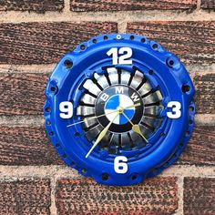 This is a handmade clock with BMW badge. Excellent for interior decor (e.g. Home, office, garage). Made from car clutch. Size: Diameter 27 cm (10.5 inches). Powered by 1x AA battery (not supplied). Also, any design is possible - just let me know and I will message you back.