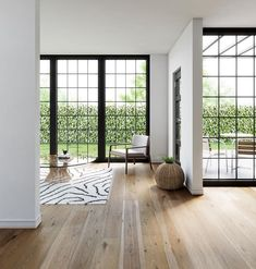 Light-toned wide plank wood flooring is often chosen for contemporary homes, as it adds visual interest to an interior without drawing attention away from other design elements. #WidePlankFlooring #LightWoodFlooring #FlooringIdeas Natural Wood Flooring, Wide Plank Flooring, Farmhouse Floor Plans, Modern Farmhouse Exterior, Carlisle, Refinishing Hardwood Floors, Interior And Exterior, Interior Design, White Oak Floors