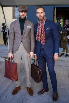 Favorite shade of blue for suits Andreas Weinas at Pitti Uomo in Florence wearing a trim blue suit with big printed scarf