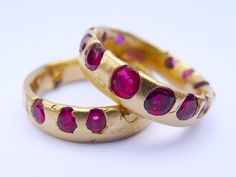 Ruby band in 18kt from Polly Wales. The stones are cast directly into the gold, then metal is polished away to reveal the gems encased.