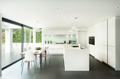 Interior, Cool Kitchen Interior Design With White Ikea Pendant Lamps White Laminate Kitchen Island With Sink White Laminate Kitchen Cabinet With Stove Lighting Under White Wall Cabinets Modern Wood Kitchen Table With White Chairs: Perfect and Ideal Kitchen Interior Design Ideas