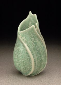 "Sandra Byers, ""Green Opening"": wheel-thrown porcelain, carved and cut, lightly glazed."
