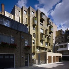 """'""""..a highly modelled brass-clad elevation was created at the rear of the building which greatly enhances the appearance of this fascinating pocket of urban space. Each apartment features a projecting balcony with a perforated brass screen which mirrors the mews facade pattern and blends harmoniously with the neighbouring buildings..""""  Luxury penthouses..'"""