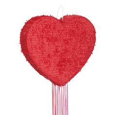A red heart shaped pinata with pull strings, this is a safe alternative to a traditional pinata. perfect for a valentine's party, a wedding or a hen party. #littlelulubel