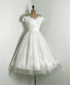 vintage 50's wedding dresses. My dream wedding dress isn't a big fluffy thing, it's a vintage teacup dress <3