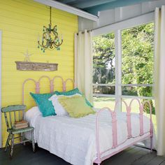Punchy Yellow Sleeping Porch - 11 Dreamy Sleeping Porches - Coastal Living