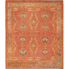 turkish oushak rug. oranges, corals, blues.