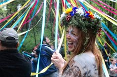 Jade Steel laughs at the maypole dance begins at an April 24 Beltane celebration. The ritual was hosted at West Hills Unitarian Universalist Fellowship by the Columbia Protogrove ADF, a local chapter of national Druid organization Ar nDraiocht Fein. (Melissa Binder/The Oregonian)